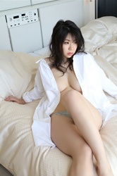Ms. Hifumi is wearing a very large white shirt and gray panties, sitting on the bed, her breasts can almost be seen, her bust is 96 cm, she is a Japanese & Asian sexy big breasts bikini model & actress, , she is a sexually attractive woman.