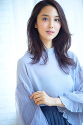 Ms. Arine is a very beautiful & elegant Japanese & Asian beauty fashion model, she is 173 cm, she is tall and slender, she has long sleeves, a light blue blouse, and a blue skirt.