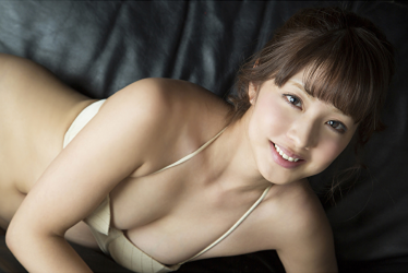 Ms. Arian took off her beautiful lady's suit and showed off her beige bikini swimsuit, she is lying on the black sofa, she is a beautiful & cute Japanese & Asian gravure idol (swimsuit model), actress, TV entertainer.