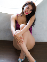 Ms. Asami sits in a sports sitting position, her bust is 89 cm, her breasts are relatively large, her body is very graceful, and she is a sexually attractive woman, she is wearing a (purple swimsuit) Japanese & Asian sexy beauty breast gravure idol (swimwear model), she is a sexually attractive woman.
