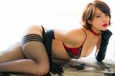 Ms. Asami is a Japanese & Asian sexy beauty gravure idol (bikini model) & actress, her bust is 89 cm, her breasts are relatively large, and her body is very graceful, she is wearing fishnet tights, black gloves, black & red lingerie, she is lying down, she is a sexually attractive woman.