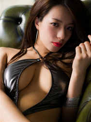 Ms. Asami is a Japanese & Asian sexy beauty bikini model & actress, she is wearing a silver swimsuit, she sits on a green sofa, her bust is 89 cm, her breasts are relatively large, her body is very beautiful, she is sexually attractive woman.