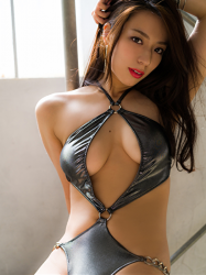 Ms. Asami is sitting, she is a Japanese & Asian sexy beauty gravure idol (bikini model) & actress, wearing a silver sexy swimsuit, her bust is 89 cm, her breasts are relatively large, her body is quite beautiful, she is a sexually attractive woman.