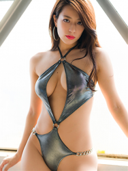 Ms. Asami is a Japanese & Asian sexy beauty gravure idol (swimsuit model) & actress, she is wearing a silver sexy swimsuit, she is standing, her bust is 89 cm, her breasts are relatively large, she has a very beautiful body, she is a sexually attractive woman.