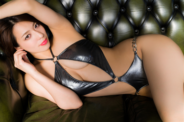 Ms. Asami is a Japanese & Asian sexy beauty bikini model & actress, she is wearing a silver swimsuit, she is lying on the green sofa, her bust is 89 cm, her breasts are relatively large, her body is very beautiful, she is sexually attractive woman.