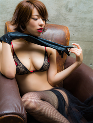 Ms. Asami is a Japanese & Asian sexy beauty gravure idol (bikini model) & actress, her bust is 89 cm, her breasts are relatively large, and her body is very beautiful, she is wearing fishnet tights, black gloves, black & red lingerie, collar, she is sitting on a brown sofa, she is a sexually attractive woman.