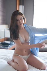 The former cabin attendant's Japanese & Asian beautiful & cute gravure idol (bikini model) Ms. Kakika finally revealed her white lingerie, she looks very sexy, & she is a sexually attractive woman, she almost takes off her light blue cutter shirt and has a full view of her white lingerie.