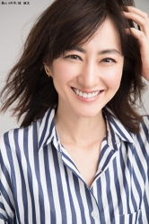 Ms. Yukako is a Japanese & Asian beautiful & elegant middle-aged fashion model in her 50s, this photo was taken from her front for modeling activities, she is wearing a blue and white striped blouse, her height is 172 cm and she is tall.
