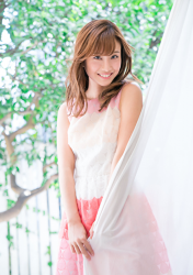 Ms. Ayaka is a very beautiful & cute Japanese & Asian model, freelance announcer, TV personality, wearing a white & pink two-color dress and holding a white curtain in her hand, she is standing.