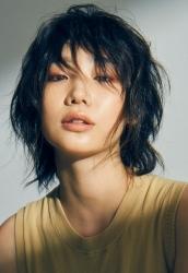 Ms. Anju was born in 1995 & she is 176 cm tall, she is a Japanese & Asian fashion model & catwalk model (runway model), she wears a beige shirt, she is a tall & slender.