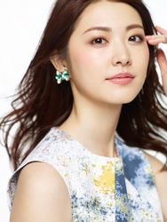 Ms. Rikomi is a Japanese & Asian mature beauty fashion model, she is wearing a brightly colorful white dress, her height is 171 cm and she is tall, her style is very good.